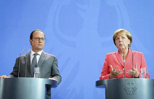 Hollande y Merkel proponen resolver juntos la crisis migratoria en Europa.