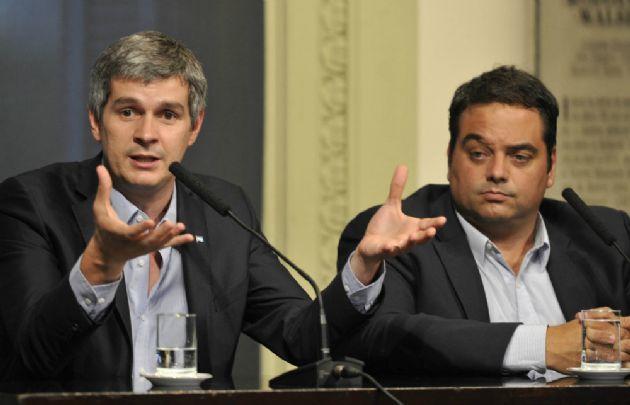 Conferencia de prensa de Peña y Triaca.