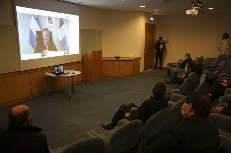FOTO: Juan Schiaretti y Luis Pagani participaron del acto de manera virtual.