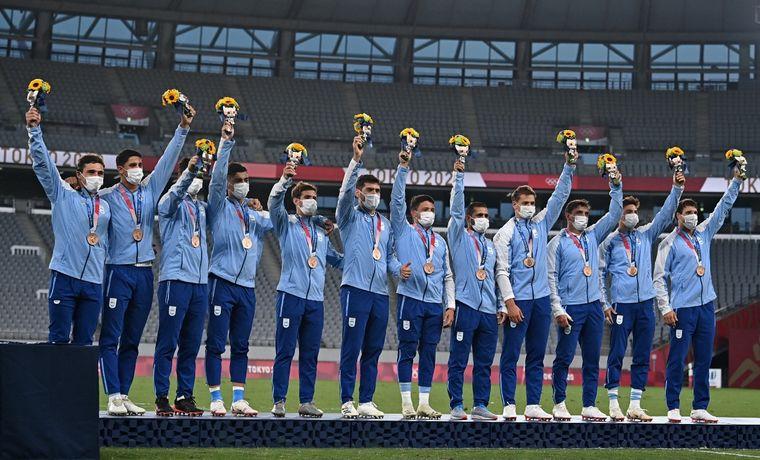 Los Pumas celebran el bronce.